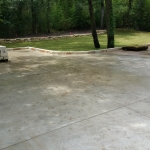 Large poured concrete slab with stone edge
